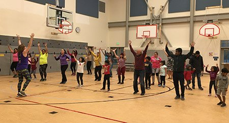 family fitness class in gymnasium