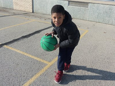 Boy Posing with Basketball