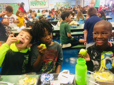 Kids Eating Fruit in Cafeteria