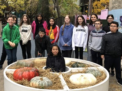 Kids Posing Around Pumpkin Display
