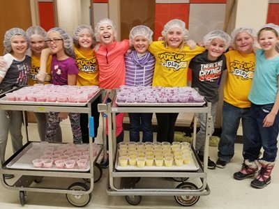 Kids with serving tray of healthy treats