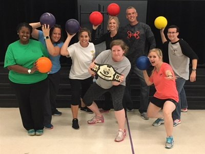 Teachers Posing With Dodge Balls